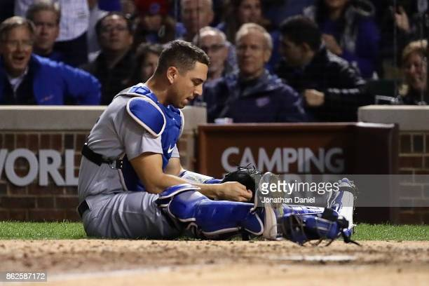 Austin Barnes of the Los Angeles Dodgers reacts after failing to catch a foul ball in the fifth inning against the Chicago Cubs during game three of...