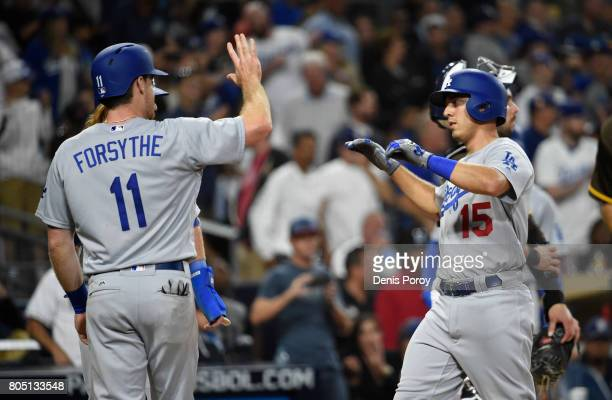 Austin Barnes of the Los Angeles Dodgers right is congratulated by Logan Forsythe after hitting a threerun home run during the sixth inning of a...
