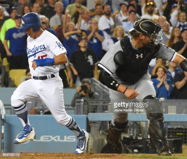 Austin Barnes of the Los Angeles Dodgers scores a run past Kevan Smith of the Chicago White Sox in the eighth inning of the game at Dodger Stadium on...
