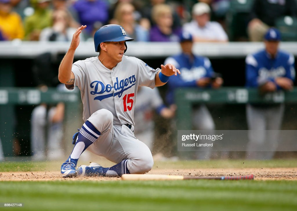 Austin Barnes #15 of the Los Angeles Dodgers scores in the seventh inning against the Colorado Rockies at Coors Field on October 1, 2017 in Denver, Colorado.