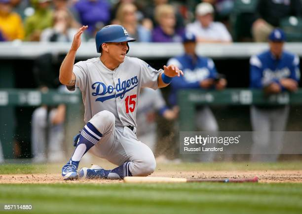 Austin Barnes of the Los Angeles Dodgers scores in the seventh inning of a regular season MLB game between the Colorado Rockies and the visiting Los...