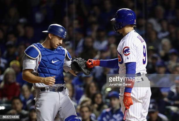 Austin Barnes of the Los Angeles Dodgers tags out Javier Baez of the Chicago Cubs after a dropped third strike in the second inning during game five...