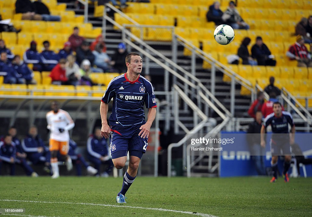 Austin Berry #22 of the Chicago Fire looks downfield during the first half of their game against the Houston Dynamo at Blackbaud Stadium on February 16, 2013 in Charleston, South Carolina.