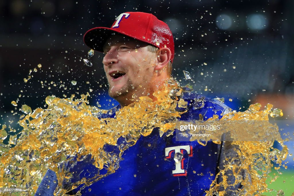 Austin Bibens-Dirkx #56 of the Texas Rangers gets soaked with a water cooler after the Texas Rangers beat the Chicago White Sox 9-8 at Globe Life Park in Arlington on August 17, 2017 in Arlington, Texas.