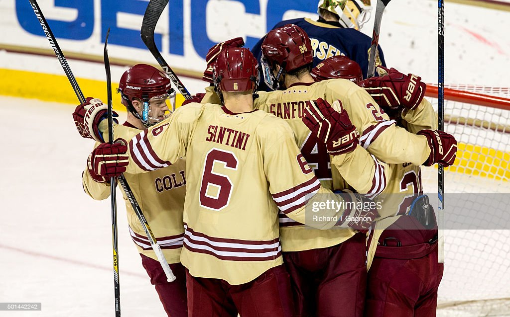 Austin Cangelosi of the Boston College Eagles celebrates his goal with teammates Zach Sanford Teddy Doherty Steve Santini and Ryan Fitzgerald during...