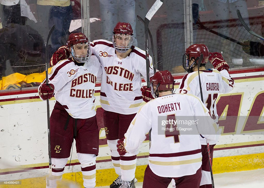 Austin Cangelosi #26 of the Boston College Eagles celebrates his second period goal against the New Hampshire Wildcats with teammates Teddy Doherty #4, Johnny Gaudreau #13 and Ryan Fitzgerald #19 during NCAA hockey action at Kelley Rink on December 6, 2013 in Chestnut Hill, Massachusetts.