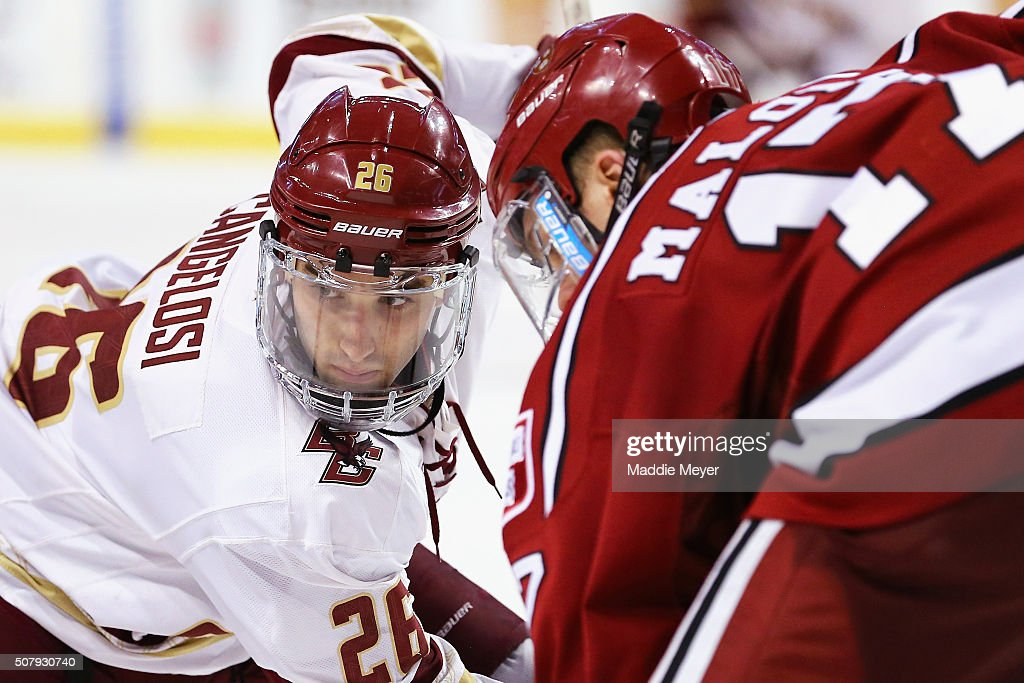 Austin Cangelosi of the Boston College Eagles prepares to face off against Sean Malone of the Harvard Crimson during the third period at TD Garden on...