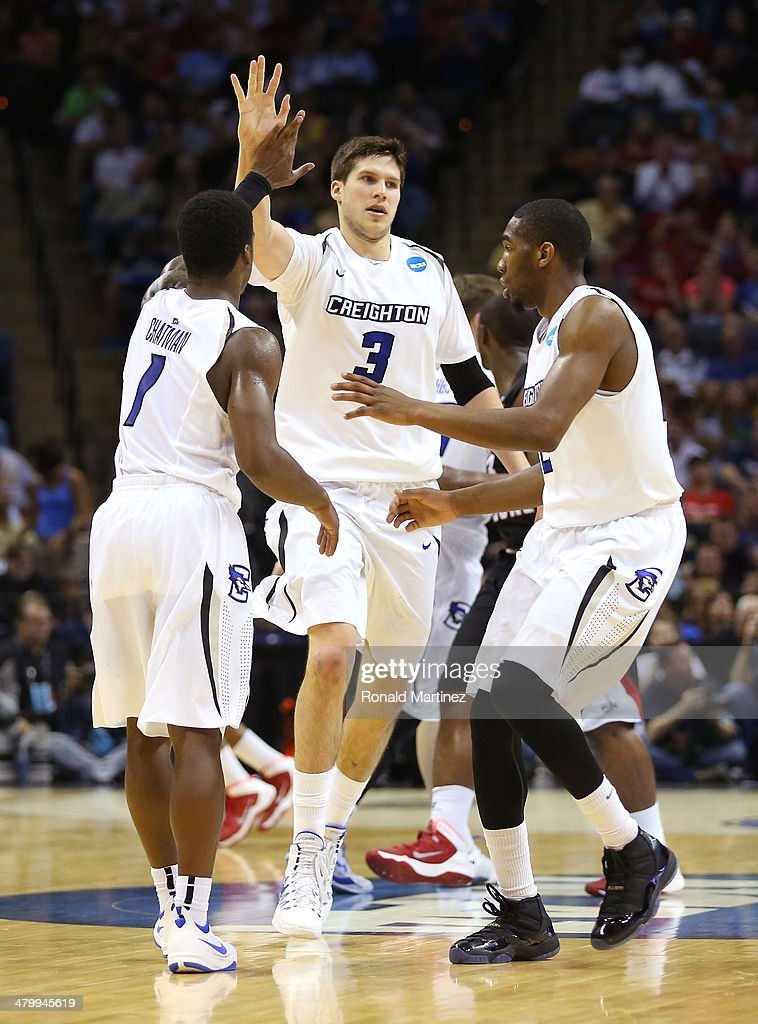 Austin Chatman Doug McDermott and Jahenns Manigat of the Creighton Bluejays celebrate after a play in the second half against the Louisiana Lafayette...