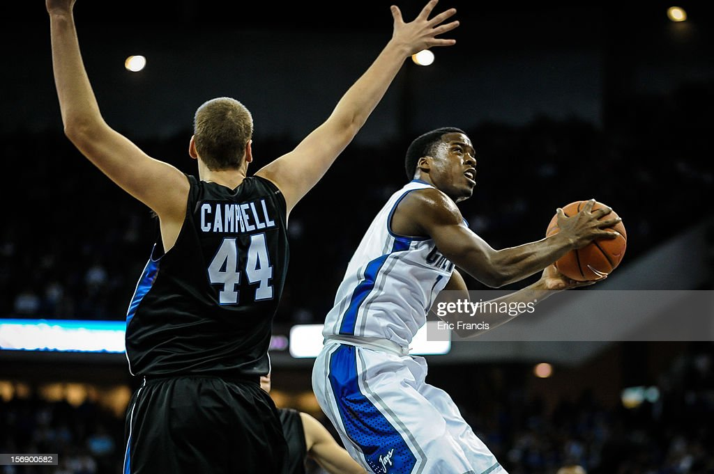 Austin Chatman #1 of the Creighton Bluejays drives around Jake Campbell #44 of the Presbyterian Blue Hose during their game at CenturyLink Center on November 18, 2012 in Omaha, Nebraska.
