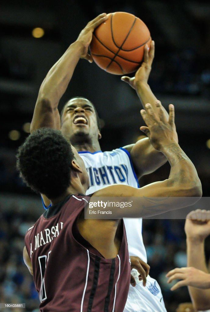 <a gi-track='captionPersonalityLinkClicked' href=/galleries/search?phrase=Austin+Chatman&family=editorial&specificpeople=8839217 ng-click='$event.stopPropagation()'>Austin Chatman</a> #1 of the Creighton Bluejays drives into Marcus Marshall #11 of the Missouri State Bears during their game at the CenturyLink Center on January 30, 2013 in Omaha, Nebraska. Creighton defeated Missouri State 91-77.