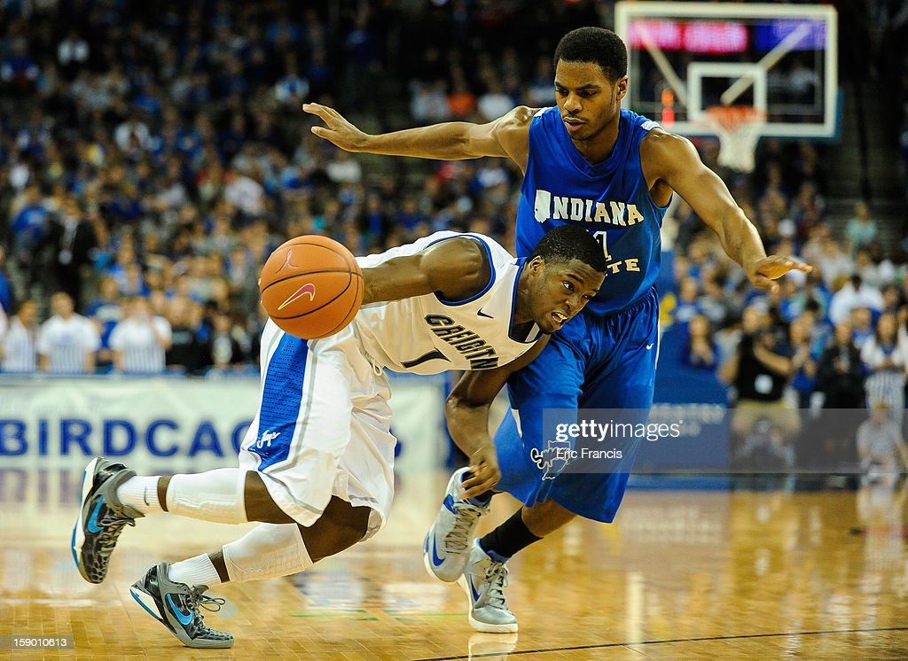 <a gi-track='captionPersonalityLinkClicked' href=/galleries/search?phrase=Austin+Chatman&family=editorial&specificpeople=8839217 ng-click='$event.stopPropagation()'>Austin Chatman</a> #1 of the Creighton Bluejays drives on Devonte Brown #11 of the Indiana State Sycamores during their game at the CenturyLink Center on January 5, 2013 in Omaha, Nebraska. Creighton defeated Indiana State 79-66.