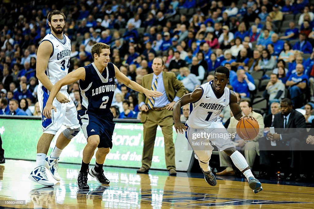 Austin Chatman #1 of the Creighton Bluejays drives past Lucas Woodhouse #2 of the Longwood Lancers during their game at CenturyLink Center on November 20, 2012 in Omaha, Nebraska.