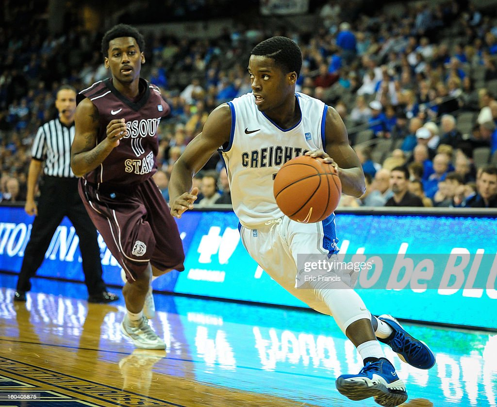 <a gi-track='captionPersonalityLinkClicked' href=/galleries/search?phrase=Austin+Chatman&family=editorial&specificpeople=8839217 ng-click='$event.stopPropagation()'>Austin Chatman</a> #1 of the Creighton Bluejays drives past Marcus Marshall #11 of the Missouri State Bears during their game at the CenturyLink Center on January 30, 2013 in Omaha, Nebraska. Creighton defeated Missouri State 91-77.