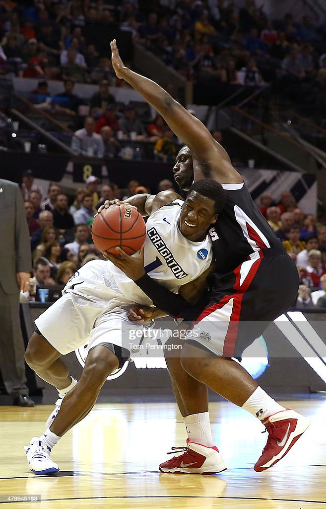 Austin Chatman of the Creighton Bluejays drives to the basket against Xavian Rimmer of the Louisiana Lafayette Ragin Cajuns in the second half during...
