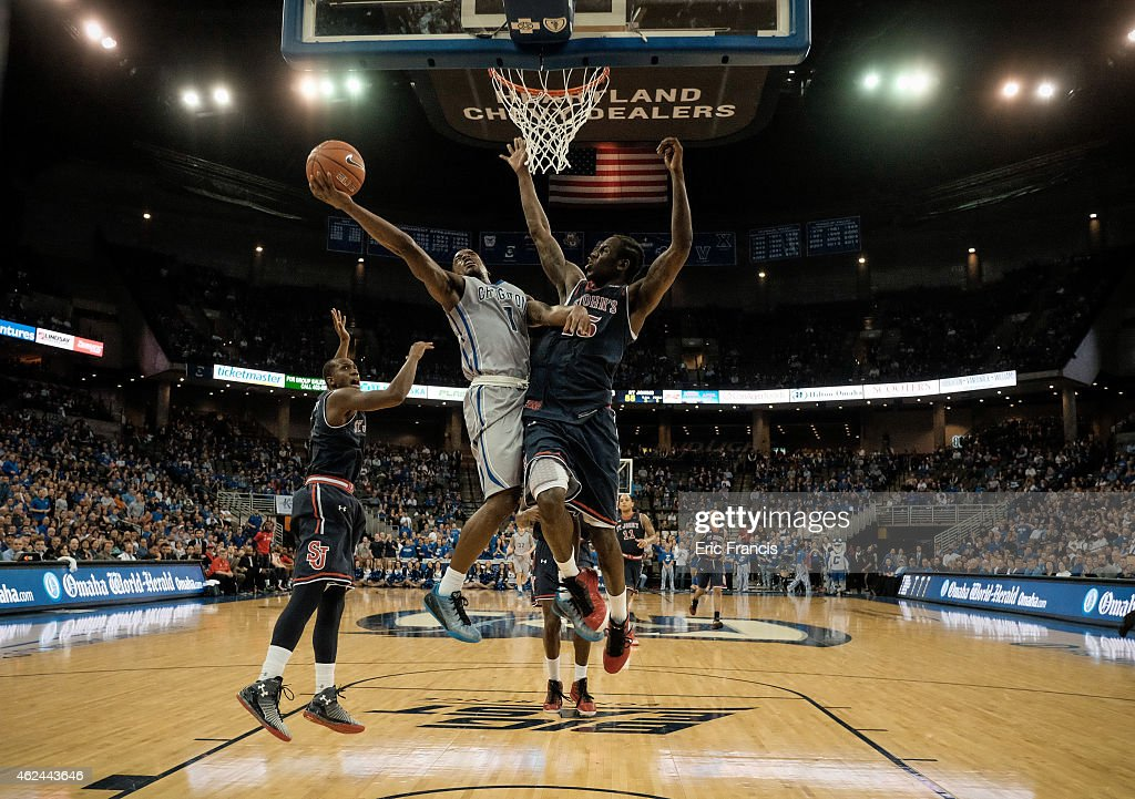 Austin Chatman of the Creighton Bluejays drives to the basket around Sir'Dominic Pointer of the St John's Red Storm during their game at CenturyLink...