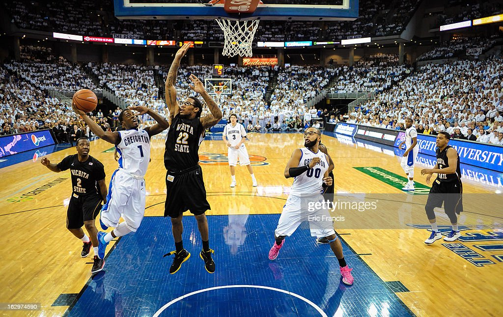 <a gi-track='captionPersonalityLinkClicked' href=/galleries/search?phrase=Austin+Chatman&family=editorial&specificpeople=8839217 ng-click='$event.stopPropagation()'>Austin Chatman</a> #1 of the Creighton Bluejays drives to the hoop against Carl Hall #22 of the Wichita State Shockers during their game at the CenturyLink Center on March 2, 2013 in Omaha, Nebraska.