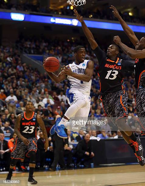 Austin Chatman of the Creighton Bluejays looks to pass the ball against Cheikh Mbodj of the Cincinnati Bearcats in the first half during the second...