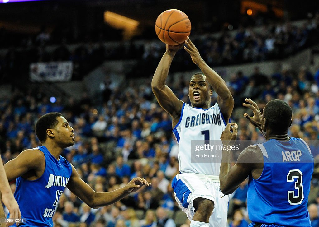 <a gi-track='captionPersonalityLinkClicked' href=/galleries/search?phrase=Austin+Chatman&family=editorial&specificpeople=8839217 ng-click='$event.stopPropagation()'>Austin Chatman</a> #1 of the Creighton Bluejays passes over Devonte Brown #11 and Manny Arop #3 of the Indiana State Sycamores during their game at the CenturyLink Center on January 5, 2013 in Omaha, Nebraska. Creighton defeated Indiana State 79-66.