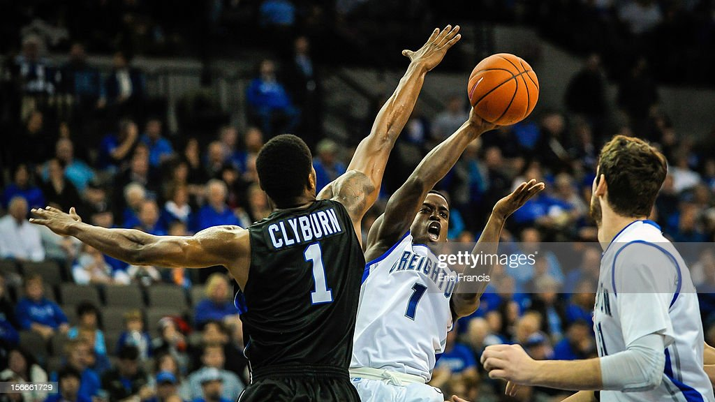 Austin Chatman #1 of the Creighton Bluejays passes the ball around Joshua Clyburn #1 of the Presbyterian Blue Hose during their game at CenturyLink Center on November 18, 2012 in Omaha, Nebraska.