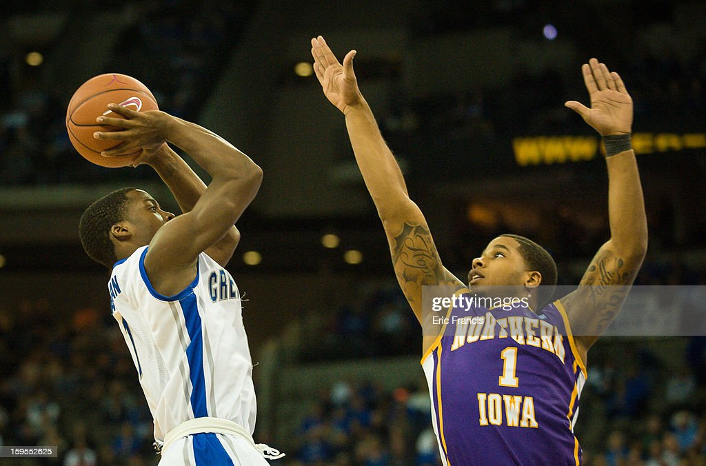 Austin Chatman #1 of the Creighton Bluejays shoots over Deon Mitchell #1 of the Northern Iowa Panthers during their game at the CenturyLink Center on January 15, 2013 in Omaha, Nebraska. Creighton defeated Northern Iowa 79-68.