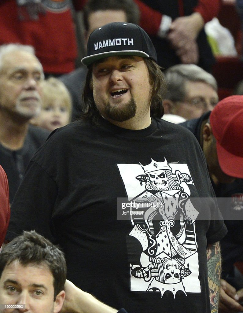 Austin 'Chumlee' Russell from History's 'Pawn Stars' television series laughs courtside as the UNLV Rebels play the Wyoming Cowboys at the Thomas & Mack Center January 24, 2013 in Las Vegas, Nevada. The Rebels won 62-50.