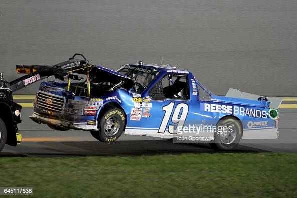 Austin Cindric's truck is towed back to the garage after a 1st lap wreck during NASCAR Camping World Truck Series NextEra Energy Resources 250 on...