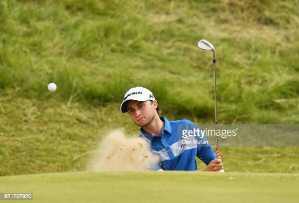 Austin Connelly of Canada hits his second shot from a bunker on the 7th hole during the final round of the 146th Open Championship at Royal Birkdale...