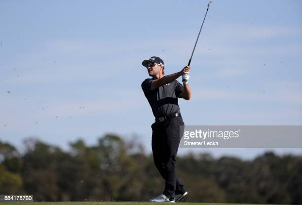 Austin Cook of United States plays his shot from the fifth tee during the final round of The RSM Classic at Sea Island Golf Club Seaside Course on...