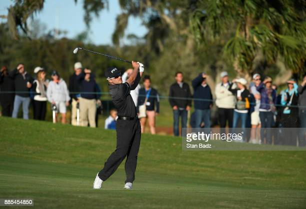 Austin Cook plays a shot on the 18th green during the final round of The RSM Classic at the Sea Island Resort Seaside Course on November 19 2017 in...