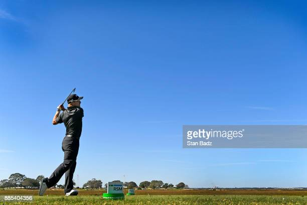 Austin Cook plays a shot on the third hole during the final round of The RSM Classic at the Sea Island Resort Seaside Course on November 19 2017 in...