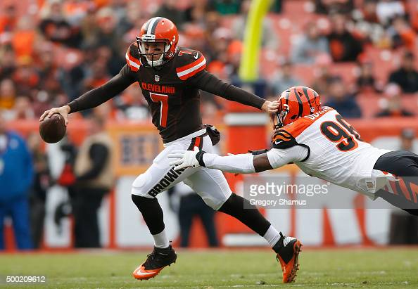 Austin Davis of the Cleveland Browns tires to out run the tackle of Carlos Dunlap of the Cincinnati Bengals during the first quarter at FirstEnergy...