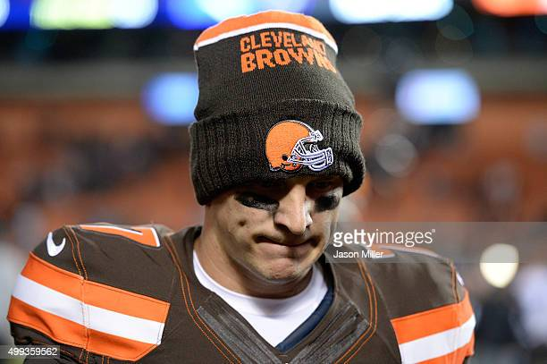 Austin Davis of the Cleveland Browns walks off the field after a 3327 loss to the Baltimore Ravens at FirstEnergy Stadium on November 30 2015 in...