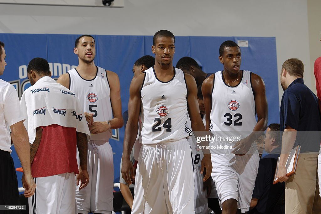 Austin Daye #5, Kim English #24 and Khris Middleton #32 of the Detroit Pistons walk against the Philadelphia 76ers during the 2012 Air Tran Airways Orlando Pro Summer League on July 13, 2012 at Amway Center in Orlando, Florida.
