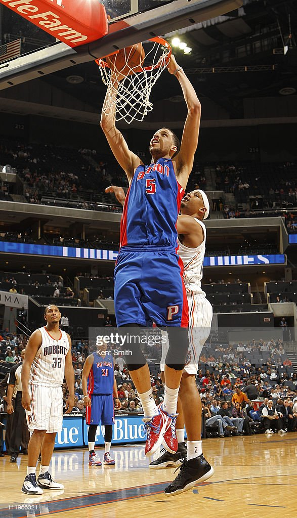 Austin Daye #5 of the Detroit Pistons puts down a dunk against the Charlotte Bobcats on April 10, 2011 at Time Warner Cable Arena on the practice court in Charlotte, North Carolina.