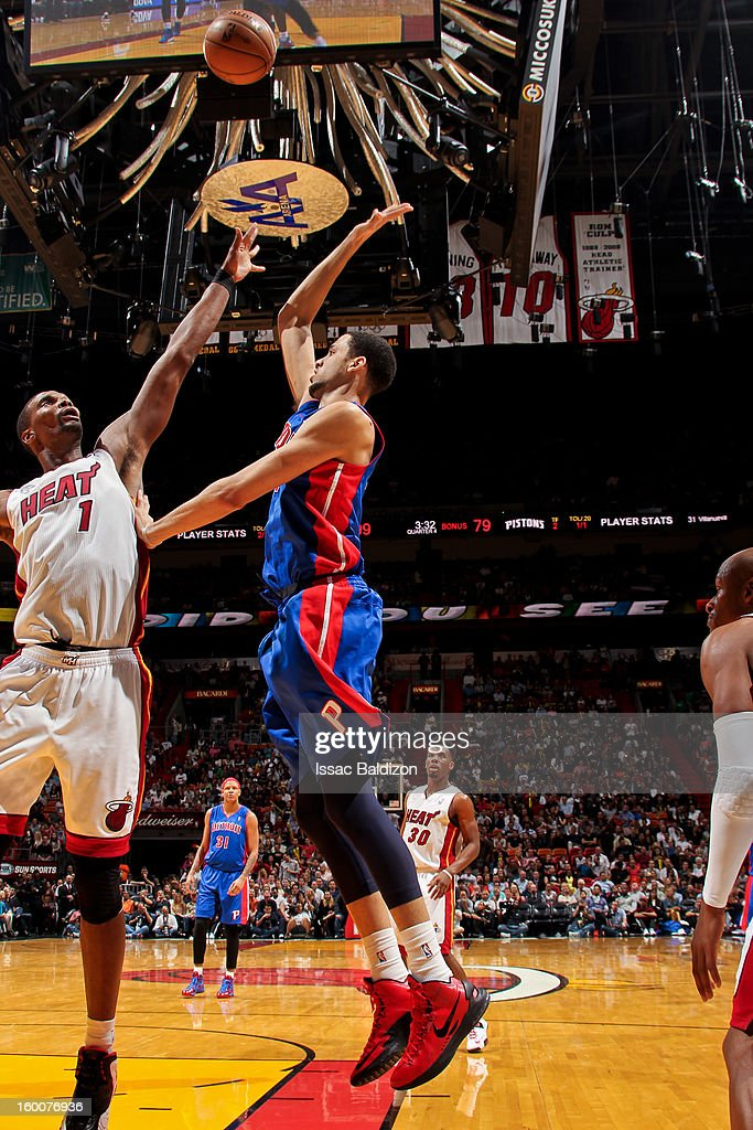 Austin Daye #5 of the Detroit Pistons shoots against Chris Bosh #1 of the Miami Heat on January 25, 2013 at American Airlines Arena in Miami, Florida.
