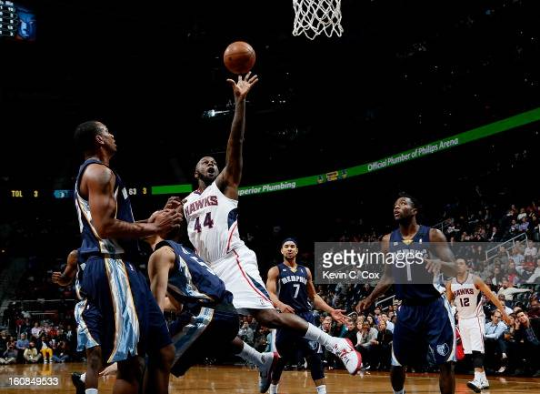 Austin Daye of the Memphis Grizzlies draws an offensive foul from Ivan Johnson of the Atlanta Hawks at Philips Arena on February 6 2013 in Atlanta...