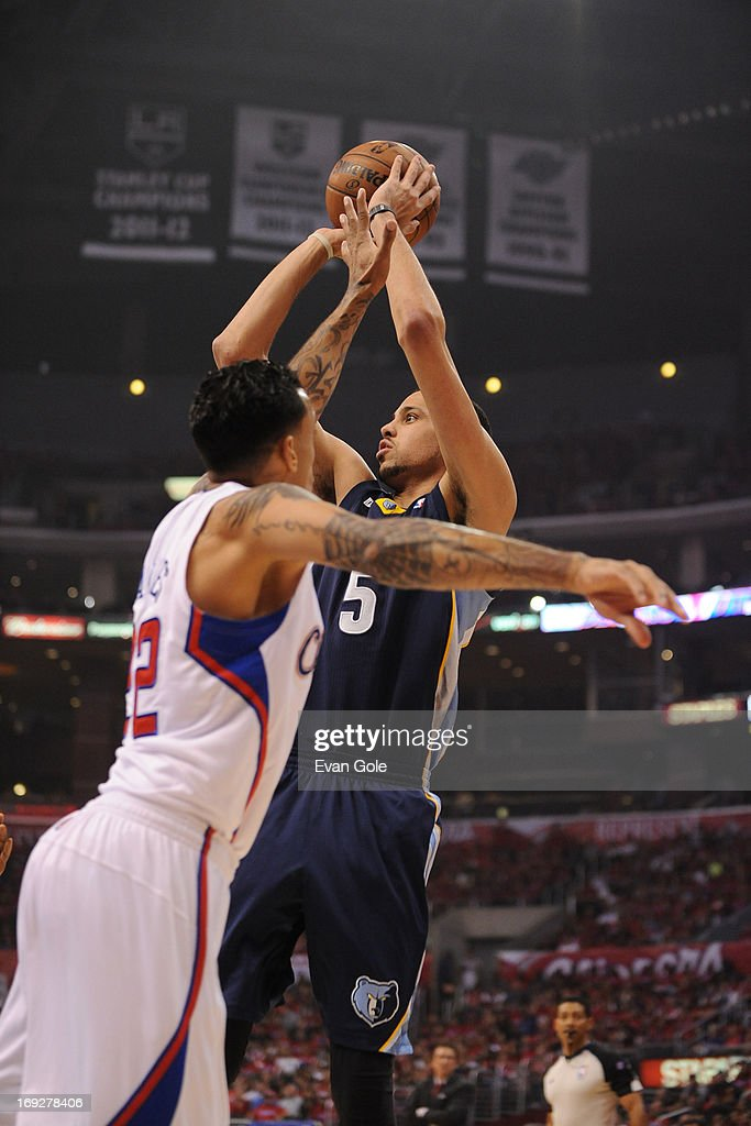<a gi-track='captionPersonalityLinkClicked' href=/galleries/search?phrase=Austin+Daye&family=editorial&specificpeople=4682416 ng-click='$event.stopPropagation()'>Austin Daye</a> #5 of the Memphis Grizzlies shoots the ball against the Los Angeles Clippers at Staples Center in Game One of the Western Conference Quarterfinals during the 2013 NBA Playoffs on April 20, 2013 in Los Angeles, California.