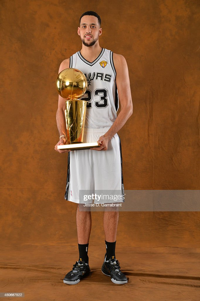 <a gi-track='captionPersonalityLinkClicked' href=/galleries/search?phrase=Austin+Daye&family=editorial&specificpeople=4682416 ng-click='$event.stopPropagation()'>Austin Daye</a> #23 of the San Antonio Spurs poses for a portrait with the Larry O'Brien Trophy after defeating the Miami Heat in Game Five of the 2014 NBA Finals on June 15, 2014 at AT&T Center in San Antonio, Texas.