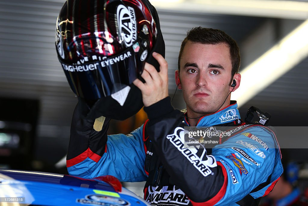 Austin Dillon, driver of the #3 AdvoCare Chevrolet, adjusts his helmet during practice for the NASCAR Nationwide Series Subway Firecracker 250 at Daytona International Speedway on July 4, 2013 in Daytona Beach, Florida.