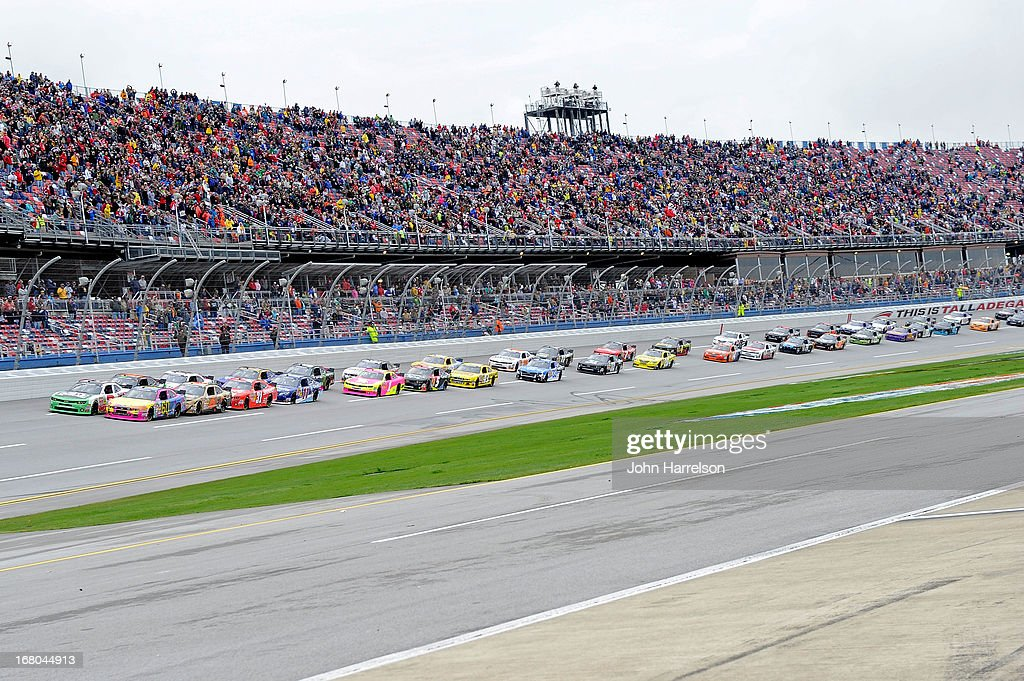 Austin Dillon, driver of the #3 AdvoCare Chevrolet and Travis Pastrana, driver of the #60 Roush Fenway Racing Ford, lead the field at the start of the NASCAR Nationwide Series Aaron's 312 at Talladega Superspeedway on May 4, 2013 in Talladega, Alabama.