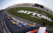 Austin Dillon driver of the AdvoCare Chevrolet and Travis Pastrana driver of the Roush Fenway Racing / RaceTrac Ford lead the field to start the...