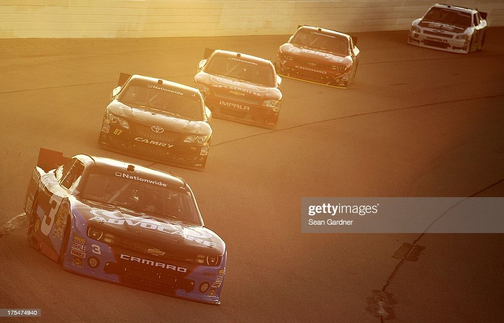 <a gi-track='captionPersonalityLinkClicked' href=/galleries/search?phrase=Austin+Dillon&family=editorial&specificpeople=5075945 ng-click='$event.stopPropagation()'>Austin Dillon</a>, driver of the #3 AdvoCare Chevrolet, leads a group of cars during the NASCAR Nationwide Series U.S. Cellular 250 Presented by Enlist Weed Control System at Iowa Speedway on August 3, 2013 in Newton, Iowa.