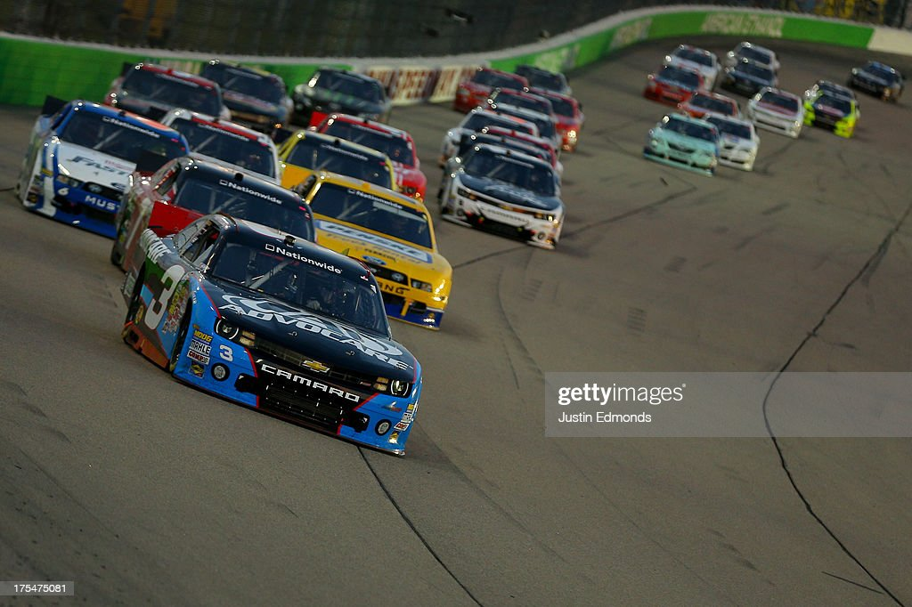 Austin Dillon, driver of the #3 AdvoCare Chevrolet, leads the field during the NASCAR Nationwide Series U.S. Cellular 250 Presented by Enlist Weed Control System at Iowa Speedway on August 3, 2013 in Newton, Iowa.