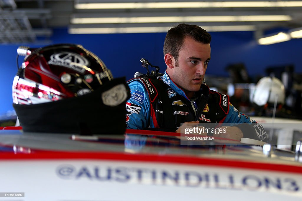 Austin Dillon, driver of the #3 AdvoCare Chevrolet, makes adjustments in the garage during practice for the NASCAR Nationwide Series Subway Firecracker 250 at Daytona International Speedway on July 4, 2013 in Daytona Beach, Florida.