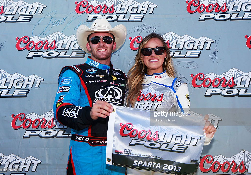 Austin Dillon, driver of the #3 AdvoCare Chevrolet, poses with the Coors Light Pole Award and Miss Coors Light Rachel Rupert after qualifying for pole position for the NASCAR Nationwide Series Feed The Children 300 at Kentucky Speedway on June 28, 2013 in Sparta, Kentucky.