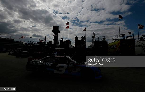 Austin Dillon driver of the AdvoCare Chevrolet pulls out of the garage for practice in the NASCAR Nationwide Series DuPont Pioneer 250 at Iowa...