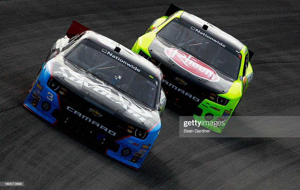 <a gi-track='captionPersonalityLinkClicked' href=/galleries/search?phrase=Austin+Dillon&family=editorial&specificpeople=5075945 ng-click='$event.stopPropagation()'>Austin Dillon</a>, driver of the #3 AdvoCare Chevrolet, races <a gi-track='captionPersonalityLinkClicked' href=/galleries/search?phrase=Kevin+Harvick&family=editorial&specificpeople=209186 ng-click='$event.stopPropagation()'>Kevin Harvick</a>, driver of the #33 Rheem/Menards Chevrolet, during the NASCAR Nationwide Series Dollar General 300 Powered by Coca-Cola at Chicagoland Speedway on September 14, 2013 in Joliet, Illinois.