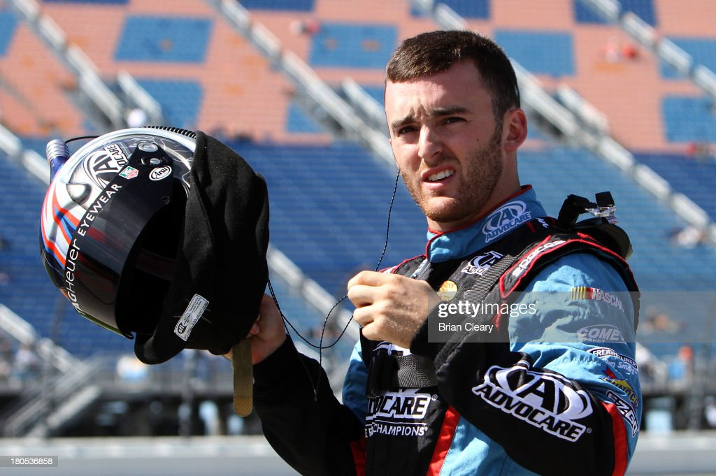 <a gi-track='captionPersonalityLinkClicked' href=/galleries/search?phrase=Austin+Dillon&family=editorial&specificpeople=5075945 ng-click='$event.stopPropagation()'>Austin Dillon</a>, driver of the #3 AdvoCare Chevrolet, stands on the grid during qualifying for the NASCAR Nationwide Series Dollar General 300 Powered by Coca-Cola at Chicagoland Speedway on September 14, 2013 in Joliet, Illinois.
