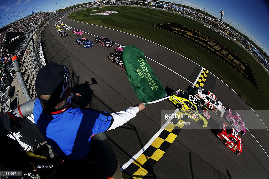 Austin Dillon driver of the AdvoCare Spark Chevrolet and Justin Allgaier driver of the Brandt Chevrolet lead the field past the green flag to start...