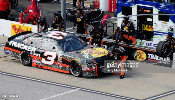 Austin Dillon driver of the American Ethanol Chevrolet pits during the NASCAR XFINITY Series Sports Clips Haircuts VFW 200 at Darlington Raceway on...